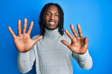 African American Man With Braids Wearing Turtleneck Sweater Showing And Pointing Up With Fingers Number Nine While Smiling Confident And Happy.