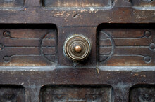 Detail Of A Round, Metallic And Gilded Knob Of An Abandoned And Deteriorated Wooden Door.