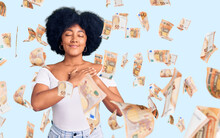 Young African American Girl Wearing Casual Clothes Smiling With Hands On Chest With Closed Eyes And Grateful Gesture On Face. Health Concept.