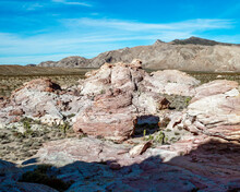 The Striped Red, Orange, Pink, And White Sandstone Rock Formations Around The Falling Man Petroglyph Trail Are Covered In Native American Rock Art.