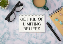 Get Rid Of Limiting Beliefs Text On The Book Isolated On Office Desk Background