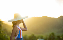 (Selective Focus) Stunning View Of A Girl With A Large Straw Hat Admiring The Palm Tree Forest Is Siargao, Philippines. Siargao Is A Tear-drop Shaped Island In The Philippine Sea.