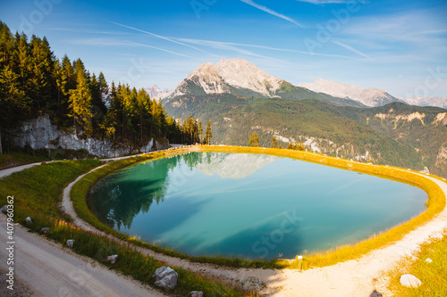 Summer scene of alpine pond and mountains on a sunny day. Location place Konigsee lake, Germany alps.