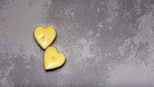 Greeting Card For Valentine Day. Two Yellow Candles In Heart Shape On Trendy Grey Backround. Love Theme. Color 2021