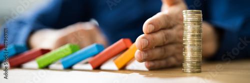 Cuadros en Lienzo Hand Stopping Falling Wooden Domino