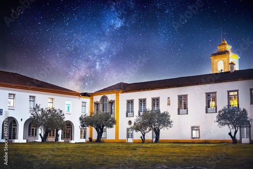 Canvas-taulu night photo of a big house with a starry sky