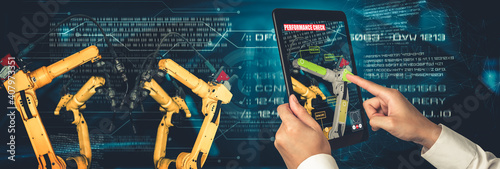 Engineer controls robotic arms by augmented reality industry technology application software. Smart robot machine in future factory working in concept of Industry 4.0 or 4th industrial revolution. © Blue Planet Studio