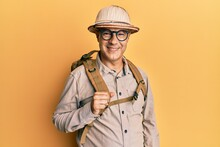 Middle Age Bald Man Wearing Explorer Hat And Backpack Looking Positive And Happy Standing And Smiling With A Confident Smile Showing Teeth