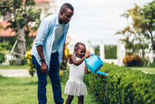 Portrait Of Enjoy Happy Love Black Family African American Father And Little African Girl Child Smiling And Play Having Fun Moments Good Time In Summer Park At Home