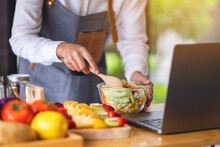 A Woman Videoblogger Cooking In The Kitchen And Filming, Online Learning Cooking Class Concept