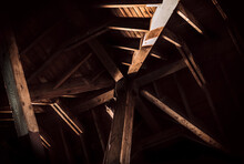 Timber Roof Truss With Beautiful Interplay Of Light And Shadows. Areas With Bright Sun And Deep Dark Shadows. Octagon Shaped Structure  Inside, Looking Up. Abstract Wood Backdrop. Selective Focus.