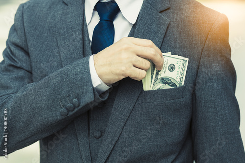 Stampa su Tela Unrecongnizable Businessman with money in suit Business man putting money in poc
