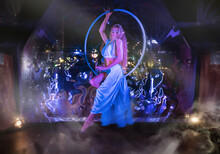 Elven Girl In Long Dress Posing On The Flying Hoop, Magical Treatment Creates A Fairy Tale Look