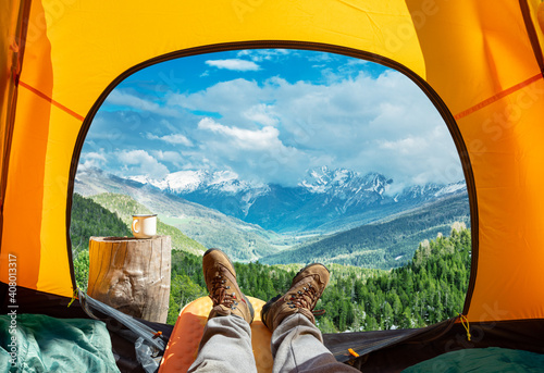 Obraz Spectacular view of nature from open tent entrance. The beauty of romantic trekking and camping. - fototapety do salonu