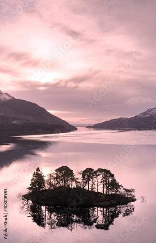 Ben Lomond at Loch Lomond during pink sunrise sky in Scotland