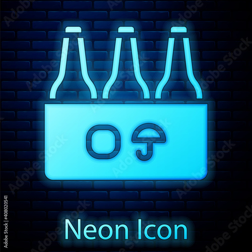Glowing neon Pack of beer bottles icon isolated on brick wall background Wallpaper Mural