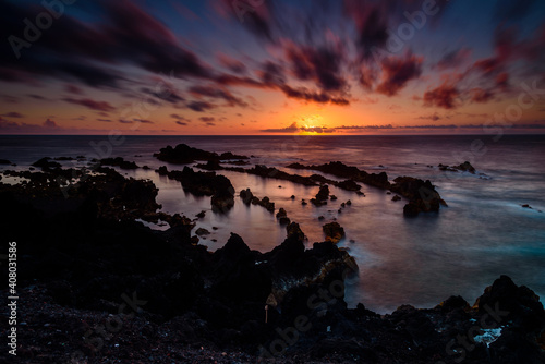 sunset on the ocean. panorama of the coast in azores islands during sunset. portugal © marinzolich