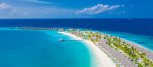 Aerial Photo Of Beautiful Maldives Paradise Tropical Beach. Amazing View, Blue Turquoise Lagoon Water, Palm Trees And White Sandy Beach. Luxury Travel Vacation Destination. Sunny Aerial Landscape