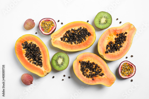 Fotografie, Obraz Fresh ripe papaya and other fruits on white background, top view
