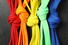 Colorful Shoelaces On Black Background, Flat Lay