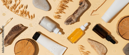 Natural cosmetic concept with serum and cream tube and bottles with natural materials - fototapety na wymiar