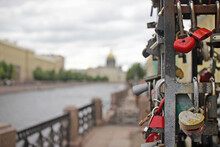 Valentines Day, Wedding And Love Concept.Simbolic Love Padlocks Fixed To The Railing Of Kissing Bridge, Saint Petersburg, Russia On Blurred Moika River View.