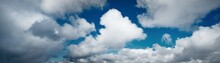 Clear Blue Sky With Glowing White Cumulus Clouds. Midday Sun. Panoramic Dramatic Cloudscape. Concept Art, Meteorology, Climate Change, Religion, Heaven, Hope, Peace, Graphic Resources