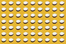 White Egg On A Yellow Background. Colorful Pattern Of Chicken White Eggs.