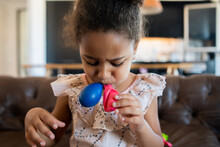 Little Girl Playing With Balloons At Home.