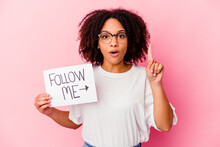Young African American Mixed Race Woman Holding A Follow Me Concept Having Some Great Idea, Concept Of Creativity.