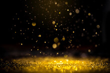 Gold Abstract Background. Glitter Lights On Black Background. Defocused.
