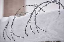 Barbed Wire Covered With Snow. Industrial Landscape, Background