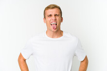 Young Caucasian Handsome Man Funny And Friendly Sticking Out Tongue.