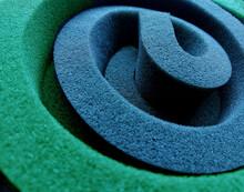 Macro Photography Of Green And Blue Sponge Foam Rolls