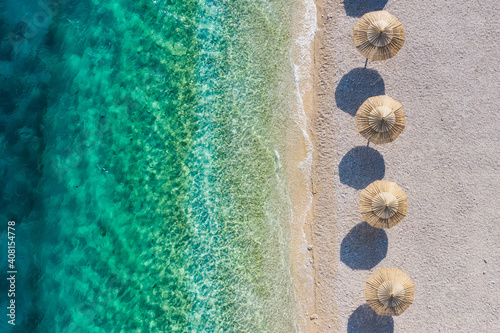 Obraz Mediterranean sea. Aerial view on the beach and umbrellas. Vacation and adventure. Coast and blue water. Top view from drone at beach and azure sea. Travel and vacation image. - fototapety do salonu