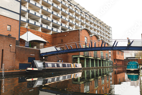 Fototapeta Many people are leaving dry land behind, living on boats UK canal system, do it because it is life they choose