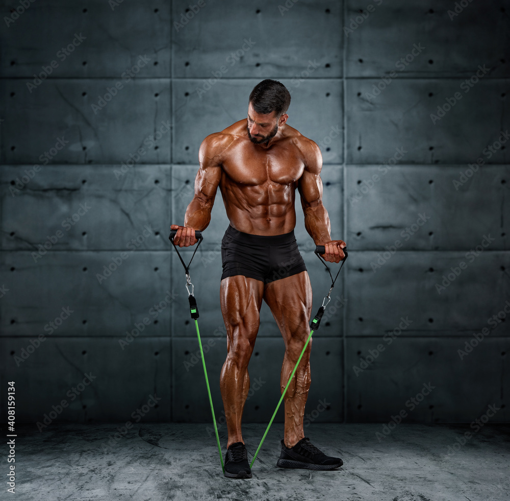 Fototapeta Muscular Men Training With Resistance Bands
