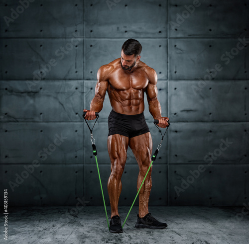 Obraz Muscular Men Training With Resistance Bands - fototapety do salonu