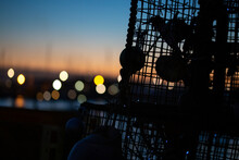 Close Up Of Stacked Lobster Pots At Dusk On The English Coast In Hampshire. Sustainable Fishing Industry Background Marina