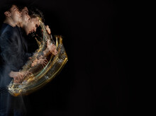 A Stroboscopic Image Of A Male Saxophone Player In Motion Against A Black Background