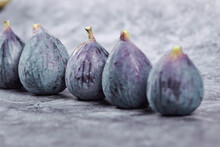 Ripe Purple Figs On A Marble Background