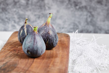 A Plate Of Purple Figs On A Marble Background