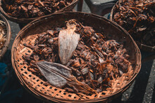 Fish And Squid Dried Seafood In Bamboo Baskets