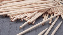 Bunch Of Toothpicks On A Wooden Surface. Macro. Dolly Shot