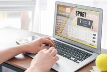 Man Placing Sports Bet At Home