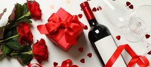 Concept Of Happy Valentine's Day With Wine, Roses And Gift Box On White Background