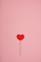 Red Wooden Love Heart On A Pink Pastel Background