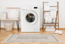 Domestic Room With Washing Machine, Baskets And Laundry Essential Things