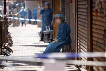 2021 Jan 23,Hong Kong.Outbreak Of The Coronavirus Disease(Covid-19),Jordan,Hong Kong.A Health Worker Stands Outside A Building Cordoned Off In The Jordan Area Of Hong Kong.