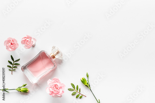 Fototapeta Transparent perfume with flowers and leaves. Flat lay, overhead view obraz